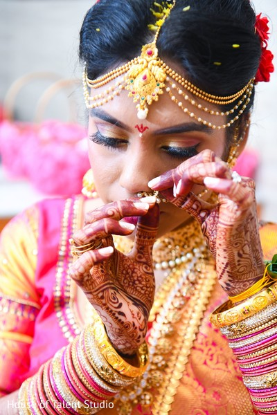 Lovely Indian bride putting her ceremony nose ring.