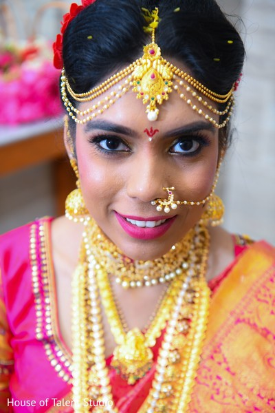 Incredible Indian bridal ceremony makeup and jewelry.
