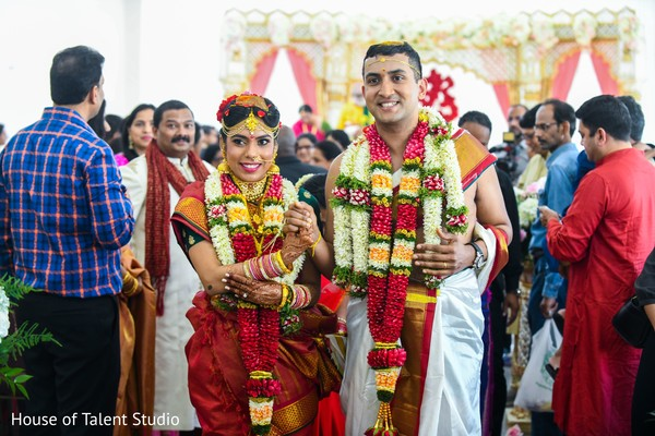 Indian couple at the end of wedding ceremony.