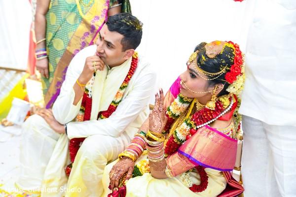 Indian couple posing at mandap.