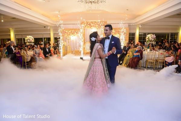 Adorable Indian bride and groom dancing