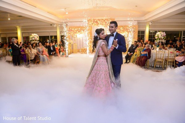Glamorous indian bride and groom dancing photography