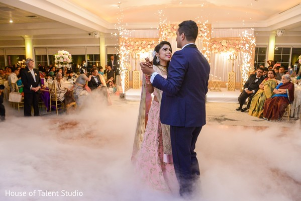 Indian bride and groom dancing during reception party