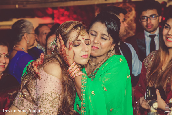 Lovely Indian bride being hug by her mother in law.