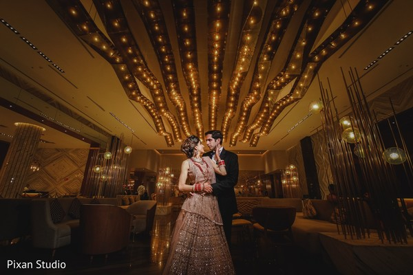 Glowing indian couple's reception look.