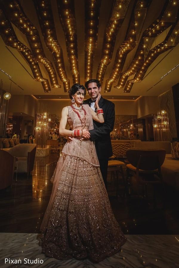Elegant Indian couple posing for photo shoot.