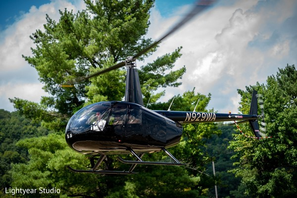Newlyweds leaving in their helicopter.