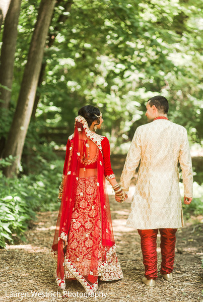 Marvelous Indian couple walking outdoors.