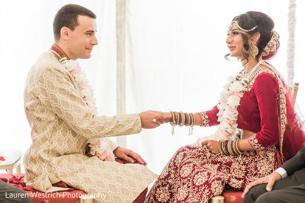 Joyful Indian couple at ceremony capture.