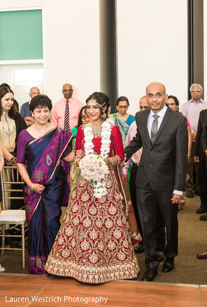 Indian bride walking in to wedding ceremony.