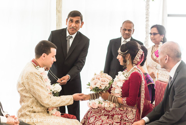 Indian groom about to put the Mangalsutra chain.