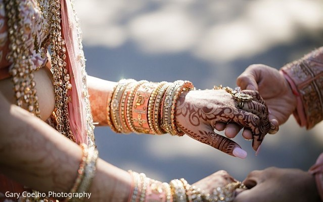 Indian bride holding hands with Raja.