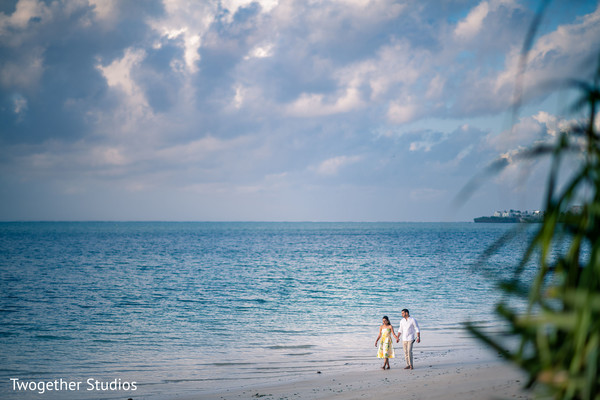 Indian couple walking by the beach.