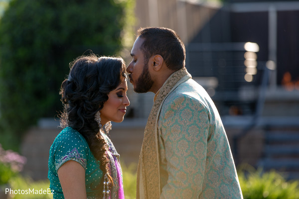 Lovely kiss of Indian groom to bride.