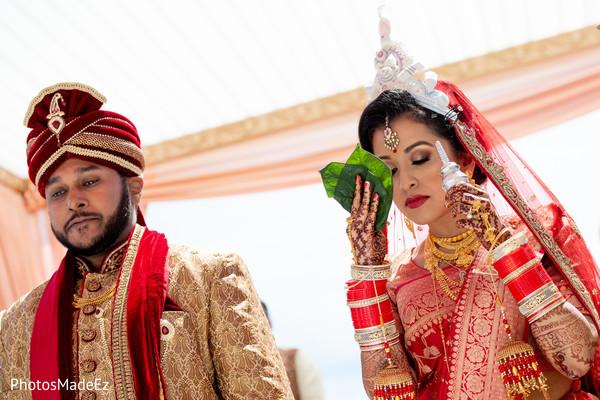 Maharani holding the ceremony ritual leafs.