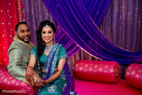 Indian lovebirds posing at Sangeet mandap.