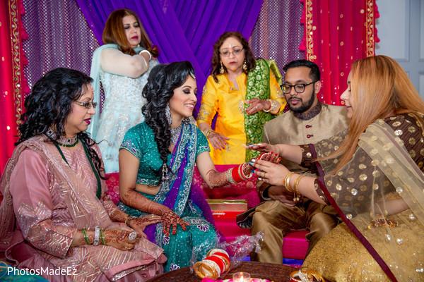 Enchanting Indian bride getting her chooras on.