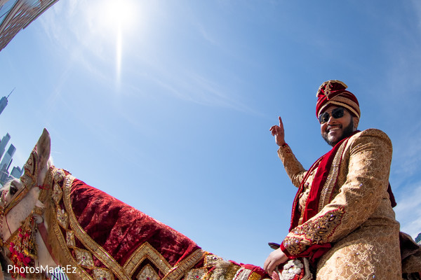 Charming Indian groom on his baraat horse.