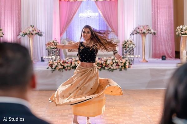 Indian wedding guest dancing.