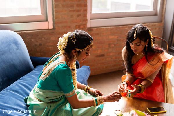 Indian bride getting her chooras on.