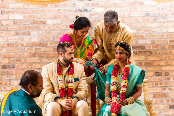 Indian couple being tied up ritual.