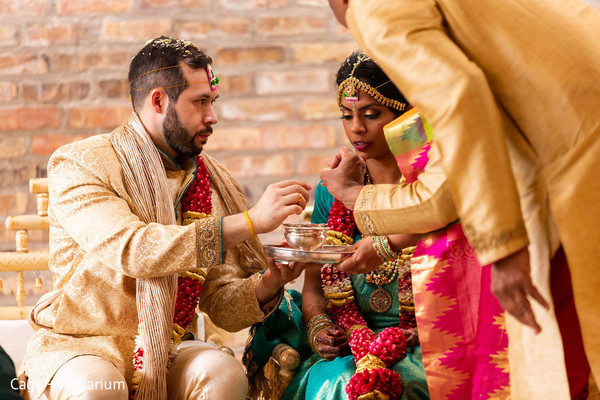 Indian couple sharing food ritual.