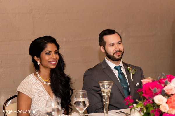 Elegant Indian couple at their table.