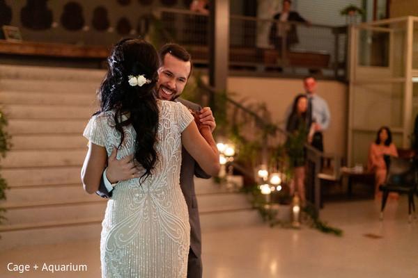 Joyful Indian couple slowly dancing.
