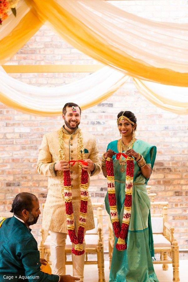 Majestic Indian couple about to exchange garlands.