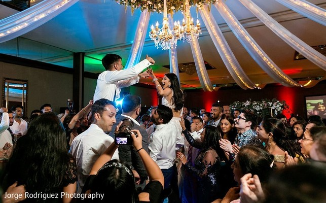 Indian bride and groom having an amazing time.