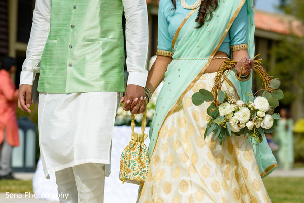 Lovely indian couple holding hands
