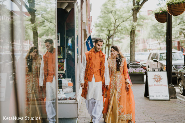 Awesome photo of our Indian couple walking on the street.