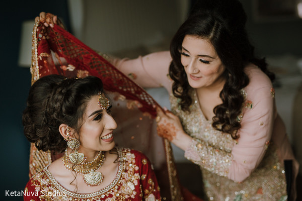 Lovely Indian bride being assisted.