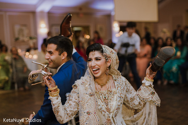 Joyful Indian couple having fun at the reception party.