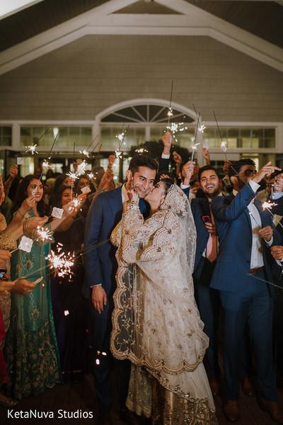 Tender Maharani giving a kiss to her groom.