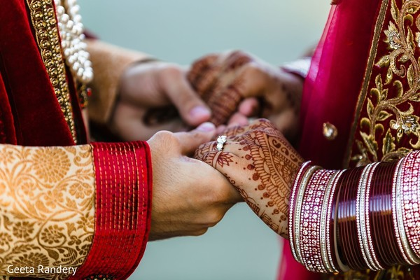 Magnificent picture of our Indian couple holding hands.