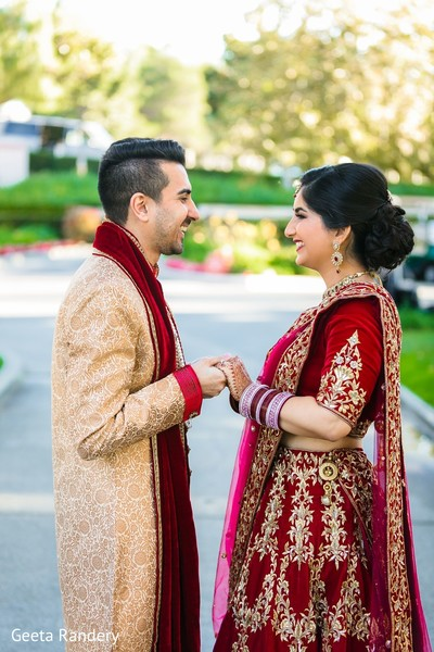 Adorable Indian couple laughing.