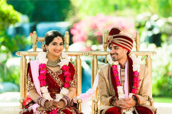 Lovely Indian couple sitting at their ceremony.