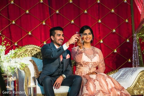 Cheers for our glamorous Indian couple.