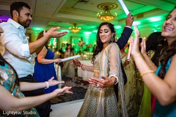 Indian bride dancing during reception party