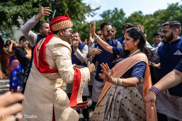 Joyful Indian groom during baraat