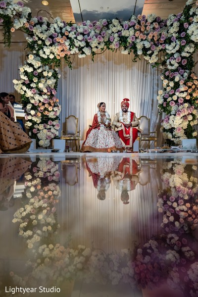 Gorgeous indian couple at their wedding ceremony stage
