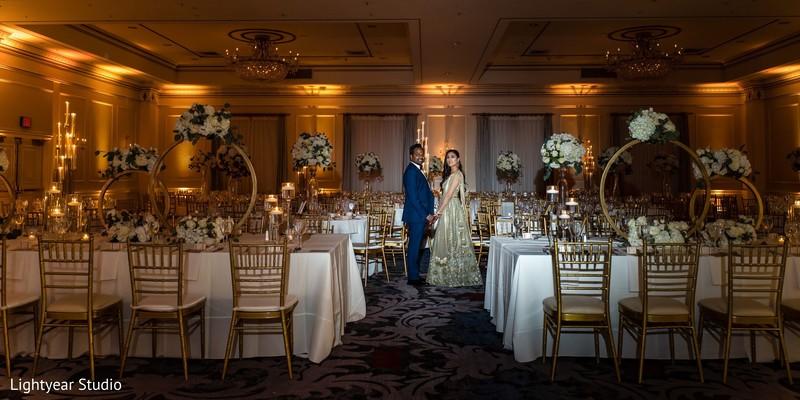 Mesmerizing indain couple showing their elegant table set up