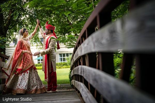 Indian groom admiring his beautiful bride