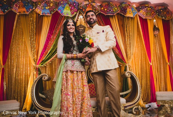 Marvelous Indian couple posing at sangeet stage.