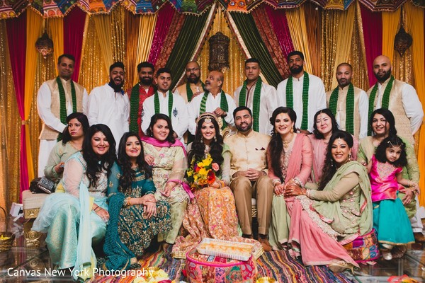 Marvelous capture of Indian couple with bridesmaids and groomsmen.