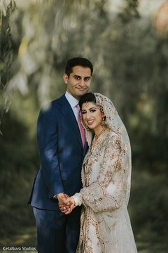 Adorable Indian couple posing for picture.