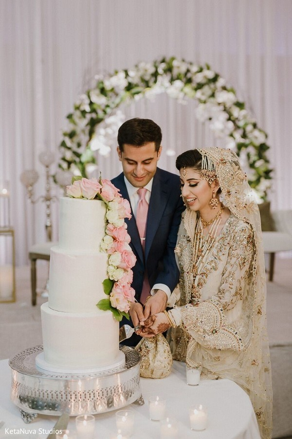 Take a look at our charming Indian couple cutting the cake.