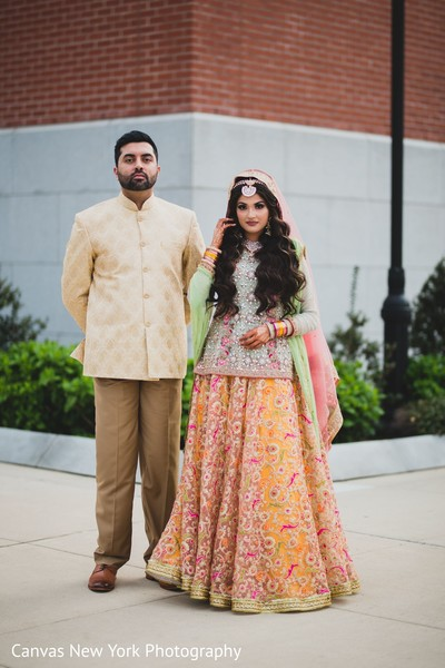 Incredible Indian bride and groom outdoors capture.