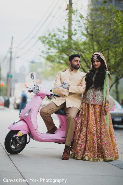 Marvelous Indian bride and groom on sangeet outfits.